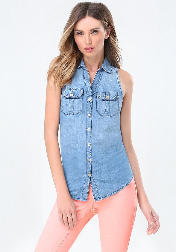 Wear-forever sleeveless denim shirt in a relaxed A-line cut. Back button slit can be undone to flash some skin. Button-flap patch pockets. Front button closures.