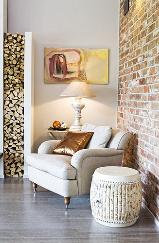 If he must have a wood-burner, here's a cool way to store the wood: fireplace niche