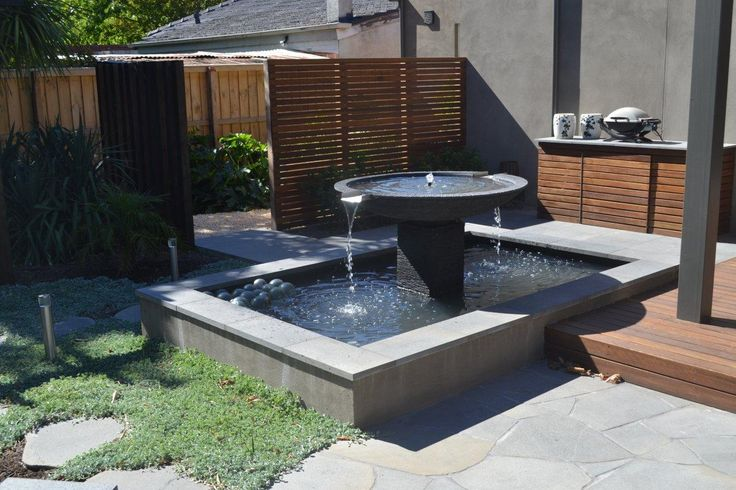 This exciting landscaping design features Bluestone in all its forms from tiles, natural round #paving stones and even carved #Bluestone for water feature.