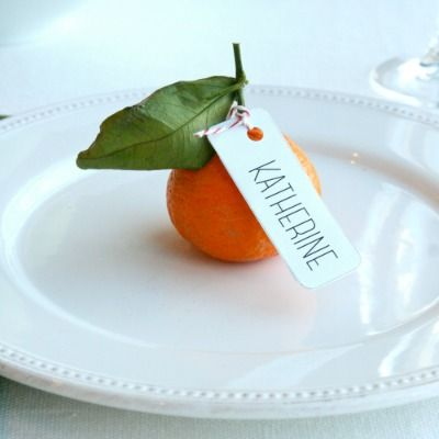 Forget store-bought stationery! Dress up your table with DIY edible place cards, like these satsumas oranges.