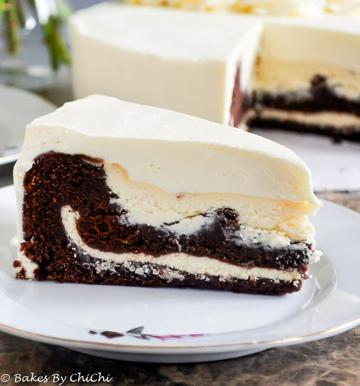 Rich chocolate cake with a creamy cheesecake filling and frosted with luscious mascarpone cream.