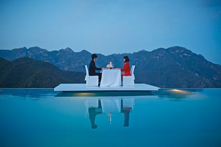 Dine on a floating platform on the infinity edge pool at for Hotels in ravello with swimming pool