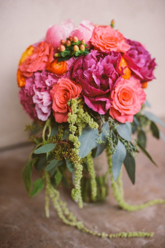 Katie's gorgeous bridal bouquet with hot pinks, corals, and oranges.  Her flowers include hydrangeas, roses, ranunculus, dahlias, hypericum berries, hanging amaranthus, and seeded eucalyptus June 21, 2014 Photo By Kj  Rob Photographers