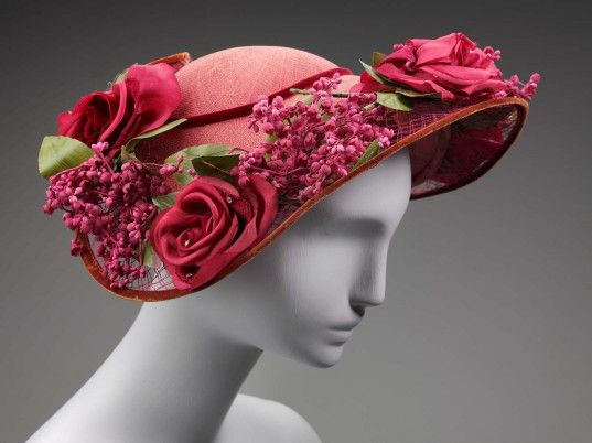 Flo-Raye, New York, Woman's hat, 1945–1955. Plaited straw trimmed with velvet, silk flowers, and rhinestones. Gift from the Collection of Violet Manno Shumsky through her estate. Museum of Fine Arts, Boston