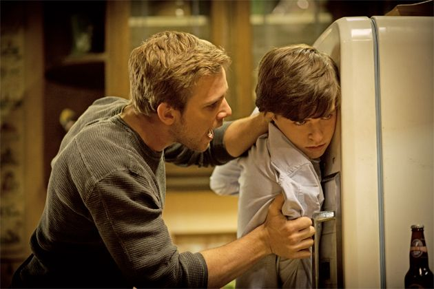 """Ep. 2 - Nice Town You Picked, Norma (Bates Motel) Pic 8/12. While Norma is out and the boys are making something to eat, Dylan gets a call on his phone from someone called """"The Whore."""" When he answers and it turns out to be Norma, Norman gets angry. Norman throws himself at his brother, but Dylan overpowers him easily. Dylan says that Norma has ruined Norman, but Norman isn't listening.  - AETV.com"""