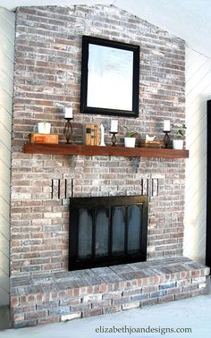 Whitewashed Brick Fireplace // I like that this still shows a lot of the brick's character while muting the palette down.