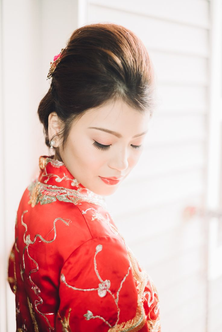 Beautiful bride in her Chinese qi pao.  Vancouver, BC, Canada Photography by Love Frankly Wedding photography