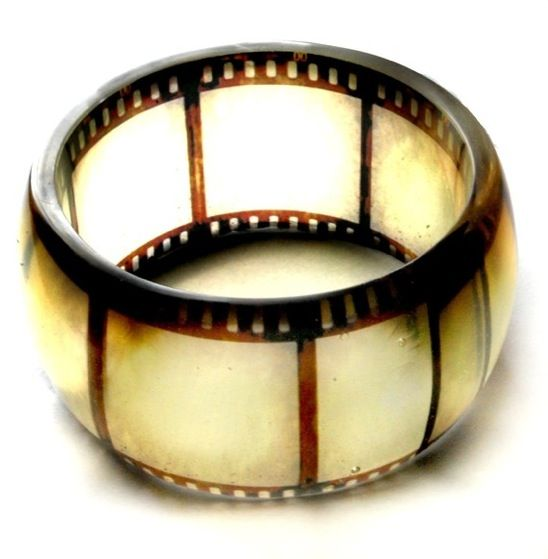 Bracelet made out of resin and old film negative.  Love this.  Great for the movie buff.