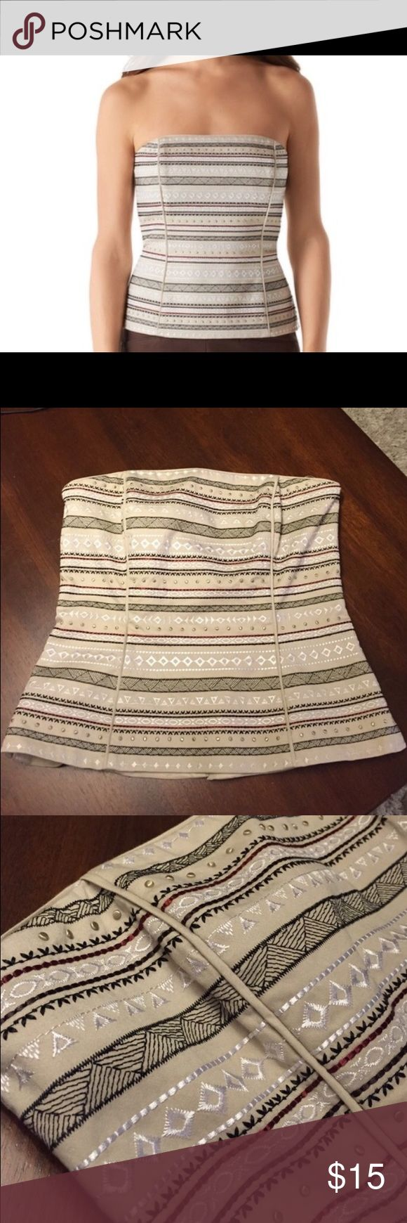 """NWOT WHBM BUSTIER NWOT pyramid studs with white, black and auburn stitching. 98% cotton, 2% spandex. Hits at the upper hip 22"""" from shoulder. Cotton lining. Boning and inner silicone elastic band to secure. White House Black Market Tops"""