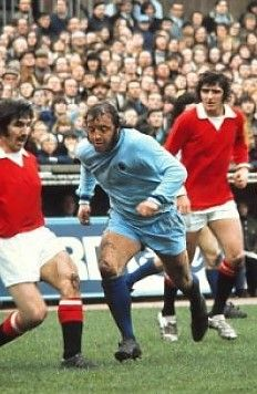 Tony Dunne challenges Coventry's Ernie Hunt watched by Ian Storey Moore