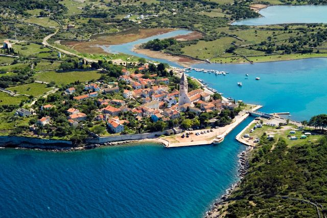 """Osor, Cres Island, Croatia.  The town of Osor is actually a huge outdoor museum, as even the great Ivan Mestrovic left his works there. Because of its numerous spa centers, opportunities for long walks, and its tradition of aromatherapy and astonishing nature, Losinj received the title of the """"Island of Vitality""""."""