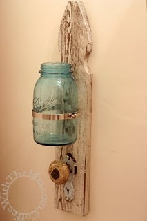 Use an old board and door knob for a toothbrush holder and towel holder!  Love it