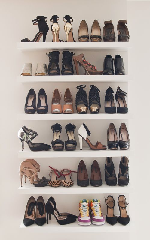 Floating shelves for shoes. You could use the Lack shelves from IKEA or floating shelves from  Target, Home Depot
