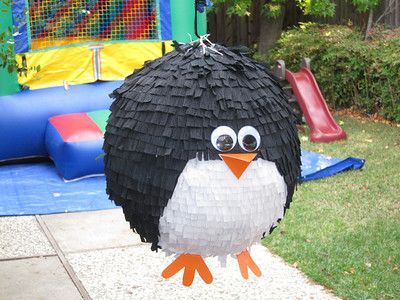 Penguin piñata. Would love to make this for Carter's party but not sure about a whole bunch of 6 year olds swinging a bat at something.
