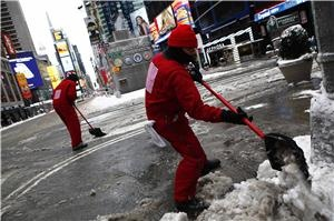 Workers clear snow at Times Square in New York, February 9, 2013. REUTERS/Eric Thayer