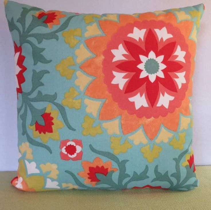 teal and red outdoor pillows