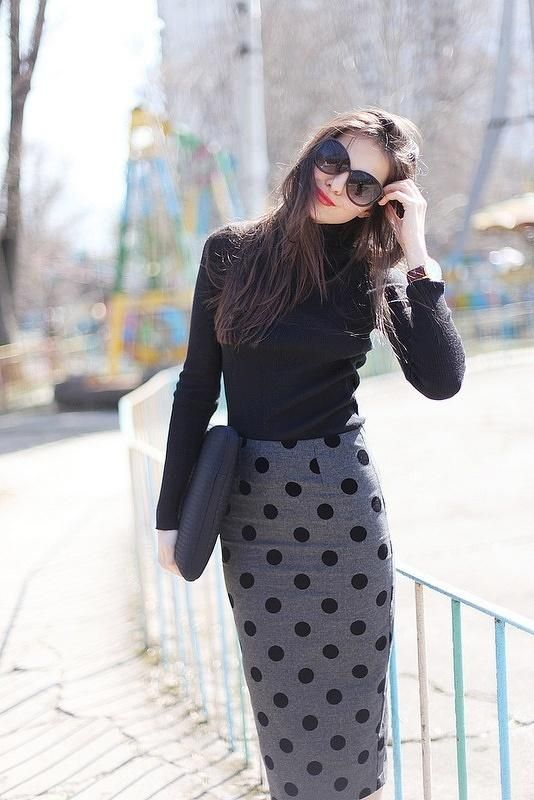 Black polka dot skirt and turtleneck.