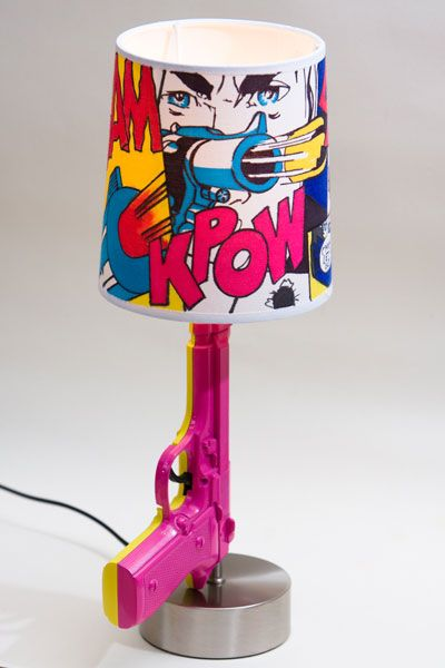 I could totally make this. Take apart an old lamp, run wires thru the gun & mod podge material over a plain lamp. Doing it.