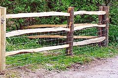 3 cleft rails on cleft Posts with stock netting- courtesy RM Fencing