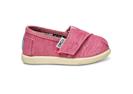 baby TOMS! i saw these on some kiddos at the Austin Children's museum and i was like 0__0 MUST HAVE.