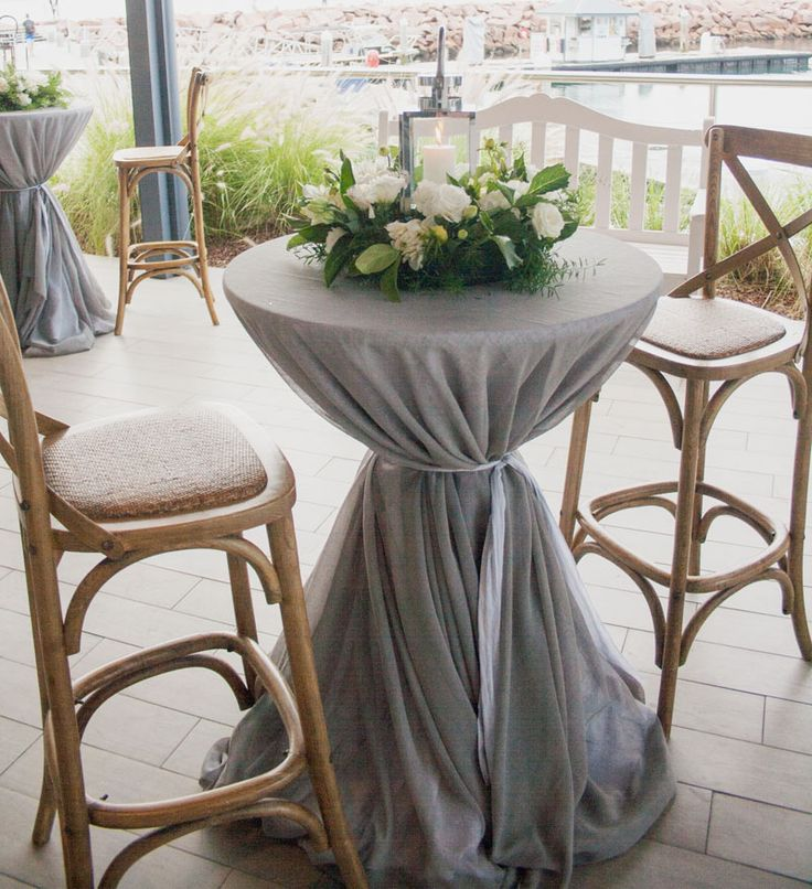 elegant blue grey sheer table linen overlays.  Cocktail wedding reception on the Chesworth Terrace at The Anchorage on the waterfront, Port Stephens NSW