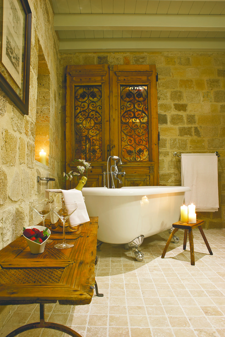 """EXCLUSIVE SUITES BOUTIQUE HOTEL. MEDIEVAL TOWN, RHODES, GREECE. - """"Katina"""" suite. The door is from a house in Saloniki. Cypress wood, ca 1930. - kokkiniporta.com"""