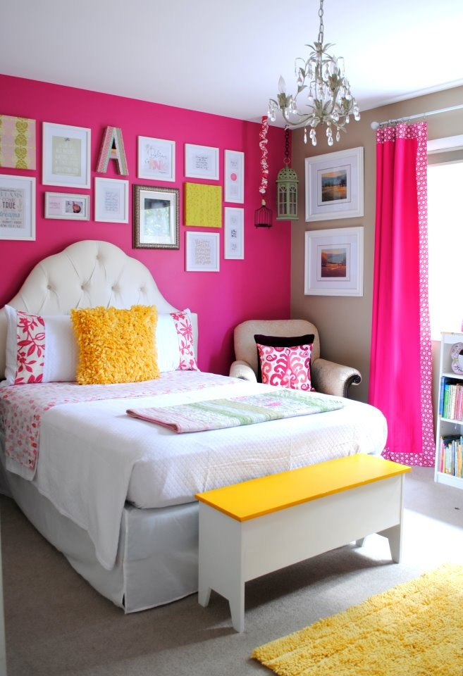 Girl's room. I like the accent hot pink wall. We can leave the other walls yellow until she grows up, then paint them this color. Nice for a grown up girl