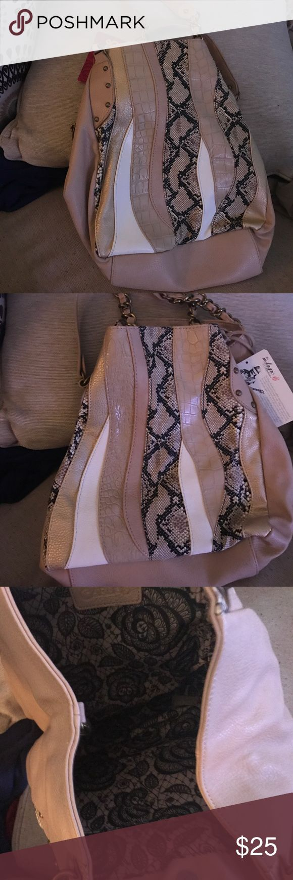 Carlos Santana pink handbag Beautiful handbag. Great for spring and summer. Great color . I promise you will get tons of compliments Carlos Santana Bags Shoulder Bags