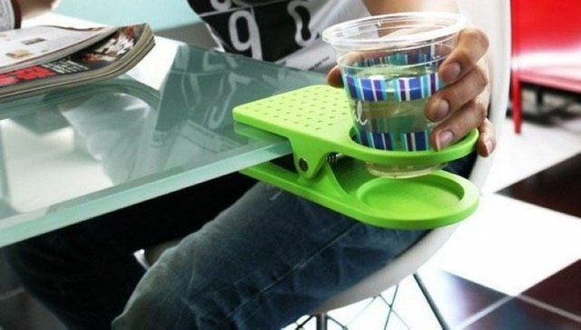 Drinklip Portable Cupholder  -  A smart extension for your space. The DrinKlip attaches to any desk, tabletop or shelf. Holds your drink, phone or other small items.