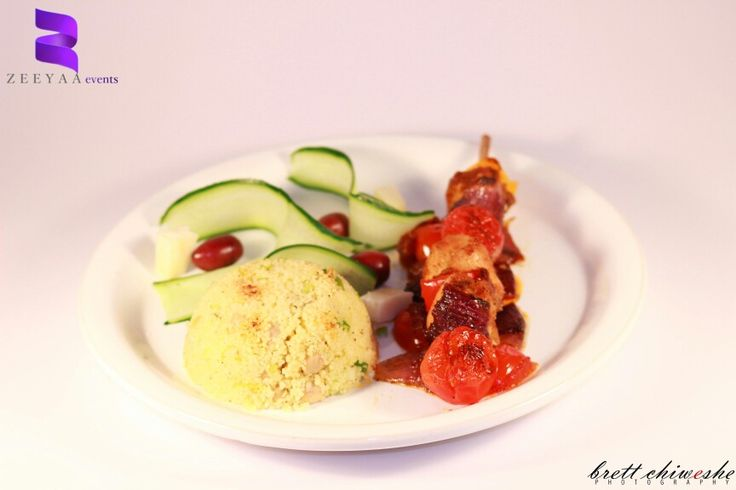 Chicken kebab served with cous cous and deconstructed greek salad