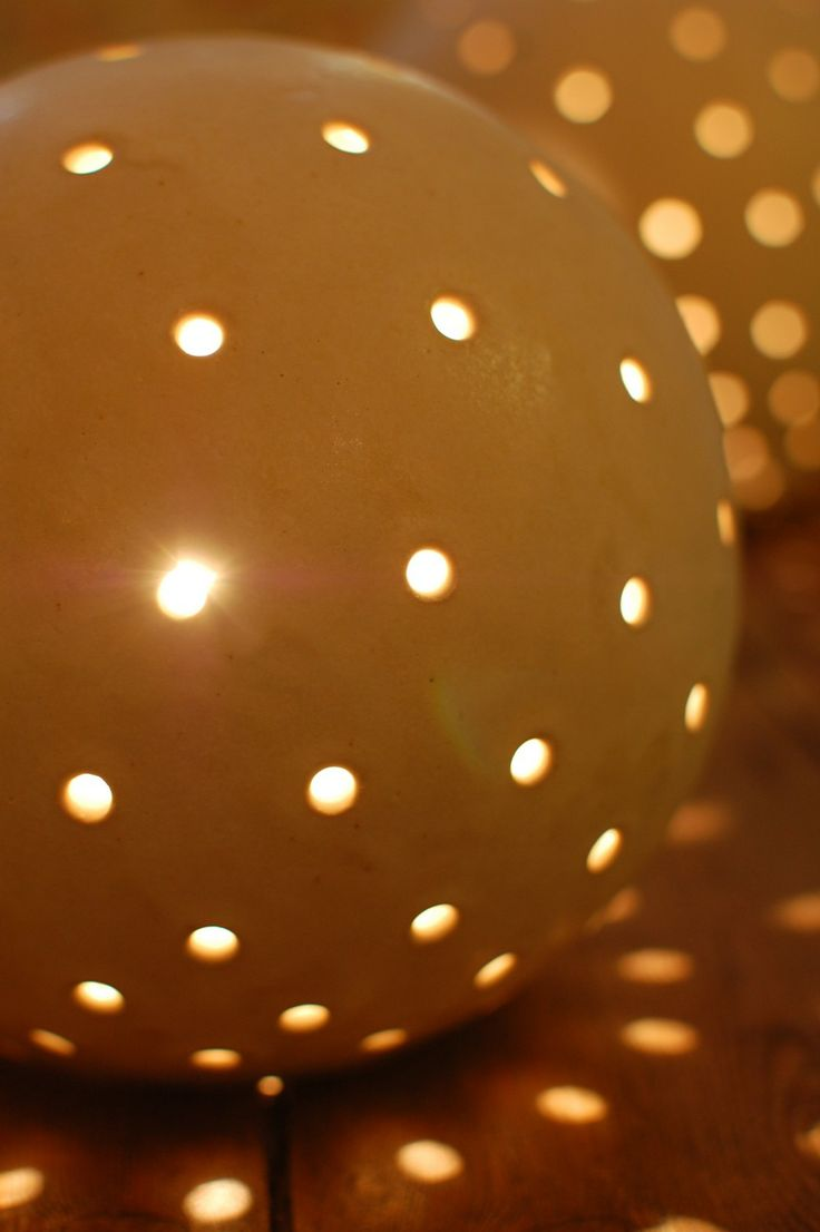 Ceramic Globe Lamp With Holes That Let The Light Shine