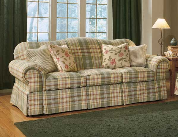 Off White Couch In Living Room With A Plaid Loveseat