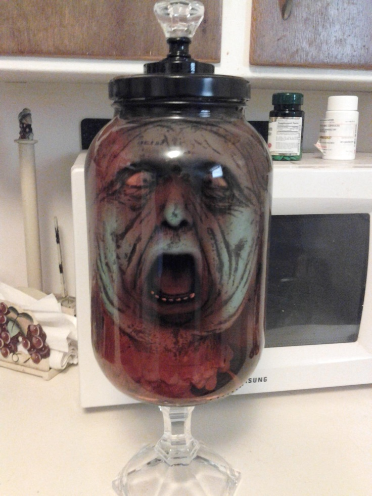Pickle jar+glass candle holder+drawer pull+creepy head from Halloween City, add red water; instant scare.