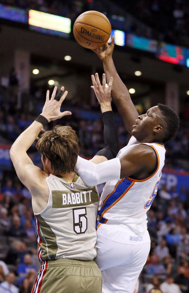 Oklahoma City's Victor Oladipo (5) shoots against Miami's Luke Babbitt (5) during an NBA basketball game between the Oklahoma City Thunder and the Miami Heat at Chesapeake Energy Arena in Oklahoma City, Monday, Nov. 7, 2016. Photo by Nate Billings, The Oklahoman