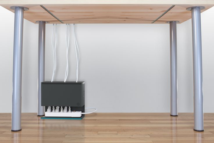 Keep your cords clean and concealed with Plug Hub, an under-desk cord management station that hides your power strip and cords in one discreet unit.