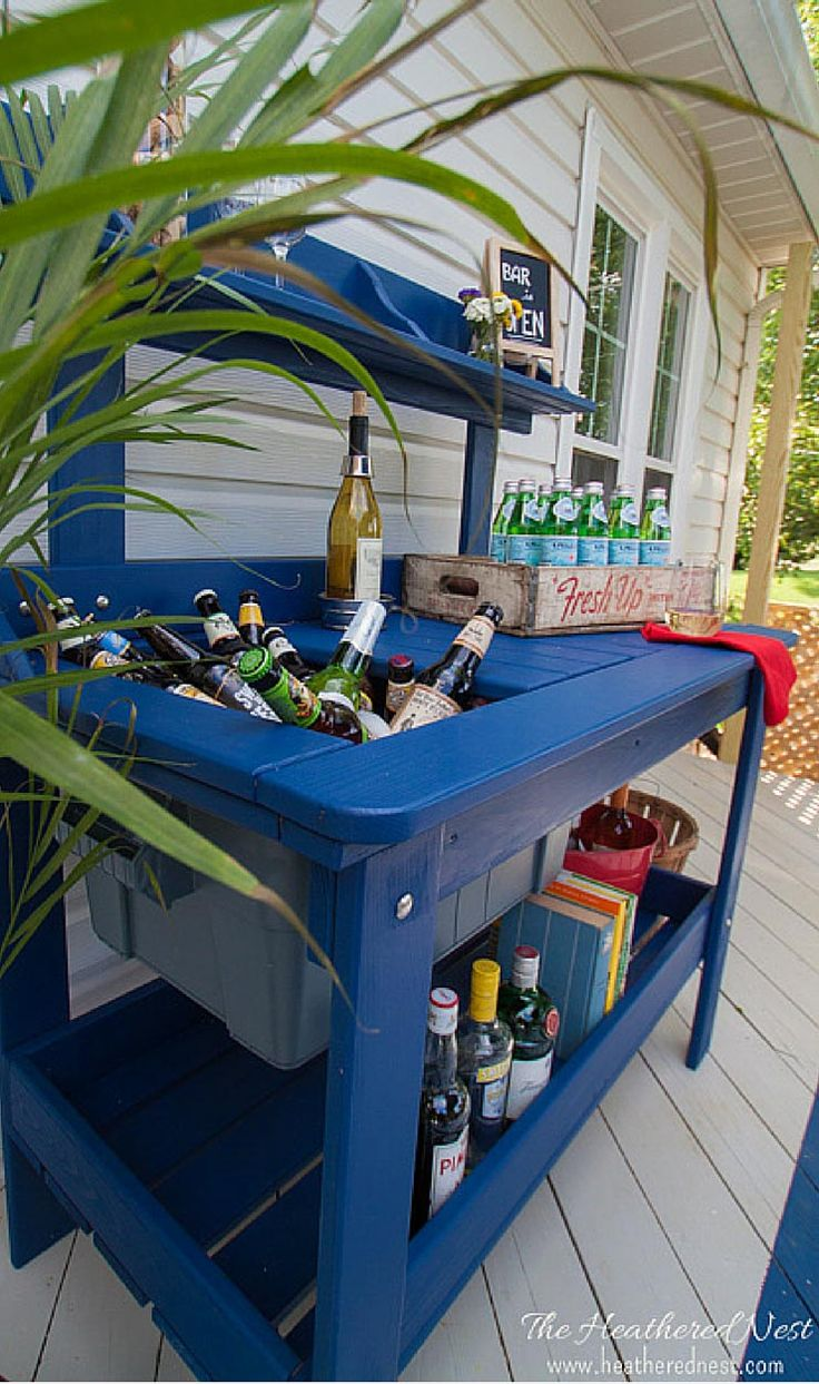 an outdoor potting table can be turned into the patio outdoor bar cart! Check out this one from www.heatherednest.com what a fun use for this type of piece!!