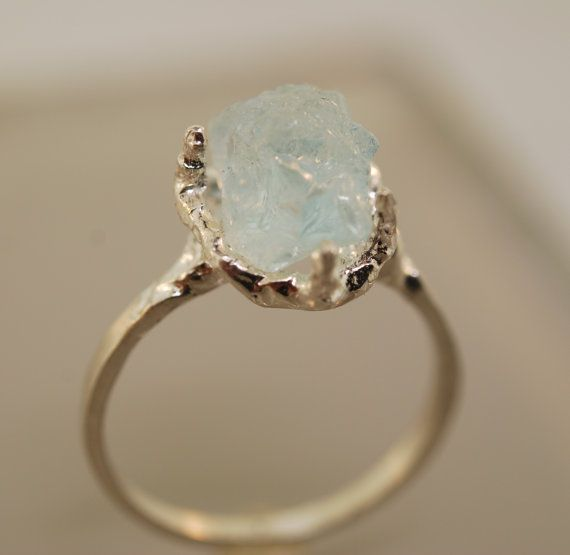 A completely unique one of a kind ring. An all natural, rough aquamarine is set in a nugget textured sterling silver ring. Each one is unique as