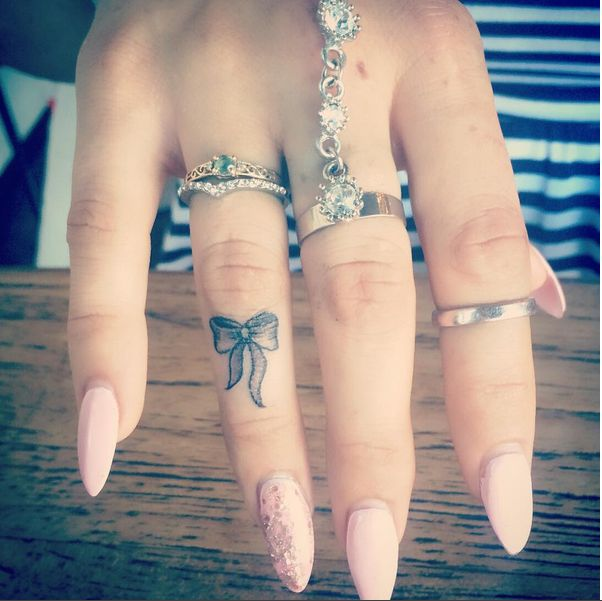 small bow finger tattoo