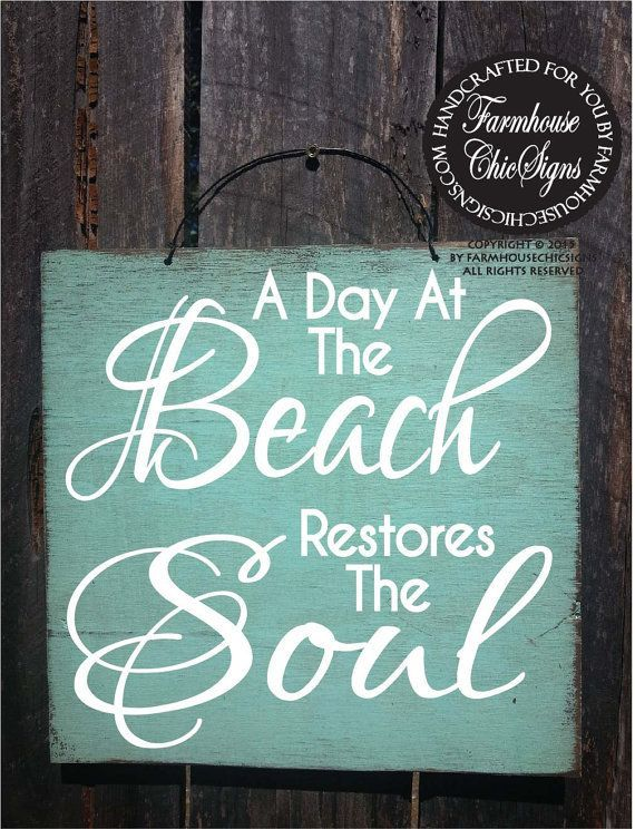 A Day At The Beach Restores The Soul sign is hand painted with a rustic look on 12x 12 outdoor plywood comes with a wire hanger on top for
