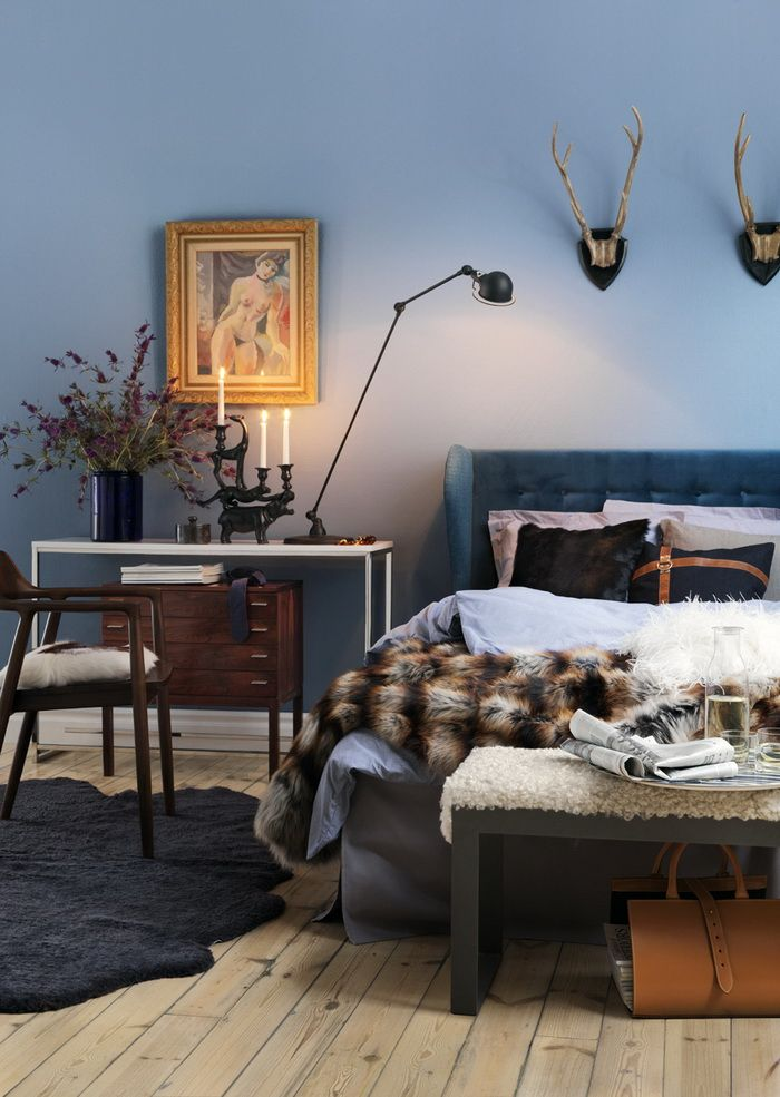 teal upholstered wingback bed + layered side tables