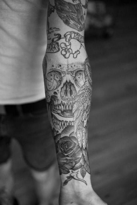 Skull forearm tattoo sleeve