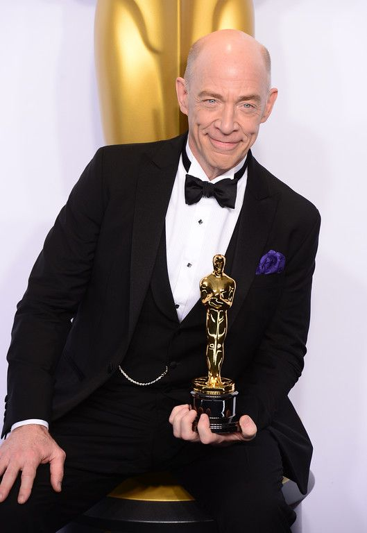 "Description of . J.K. Simmons poses backstage with the Oscar for best Actor in a Supporting Role for ""Whiplash"" at the 87th Academy Awards on Sunday, Feb. 22, 2015. (Photo by David Crane / Los Angeles Daily News)"