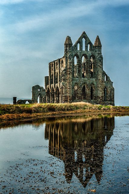 Whitby Abbey is a ruined Benedictine abbey overlooking the North Sea on the East Cliff above Whitby in North Yorkshire, England. It was disestablished during the Dissolution of the Monasteries under the auspices of Henry VIII.