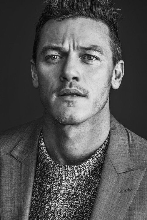 """womensweardaily: Luke Evans: Slaying Them Softly Photo by Rodolfo Martinez In the photo studio, Evans shows a different side of himself than the one viewers are accustomed to in full-throttle genre movies. He waits for a photographer to set up when """"Trouble,"""" a melancholy love song from the singer-songwriter Ray LaMontagne, comes on. Almost under his breath, the actor starts singing to himself. He knows all the words. For More"""