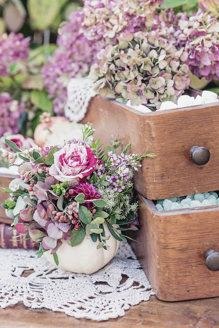 vintage drawers, pumpkins and flowers for a fall wedding