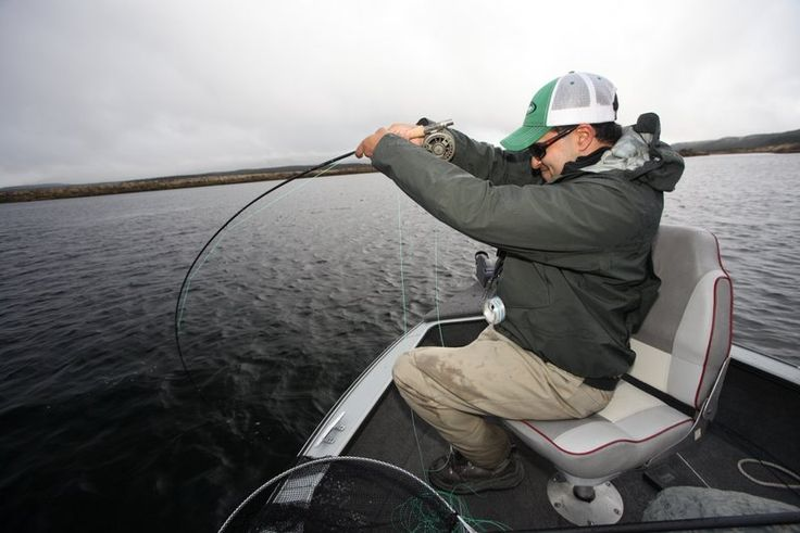 Rene Vaz watches as his big stillwater Rainbow races down under the boat.
