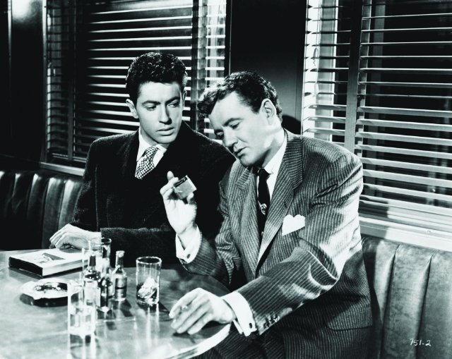 """Bruno Anthony (Robert Walker) to Guy Haines (Farley Granger): """"My theory is that everyone is a potential murderer."""" -- from Strangers on a Train (1951) directed by Alfred Hitchcock"""