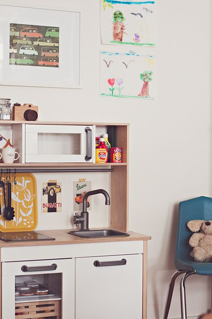So cute, and realistic mini kitchen!  Love the cookie sheet on the backsplash.