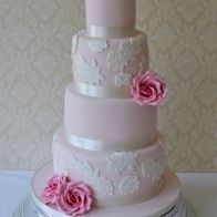 CakeSweetCake; soft pink icing with vintage ivory lace and pink sugar flowers