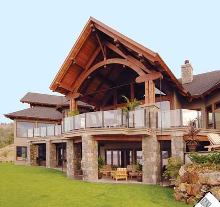 back porch...love the stone, love the timber frame.
